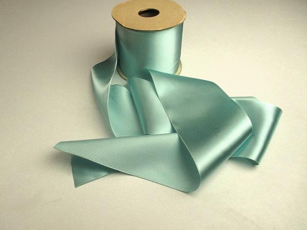 Wide aqua sash ribbon