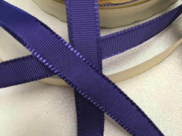 Narrow purple ribbon